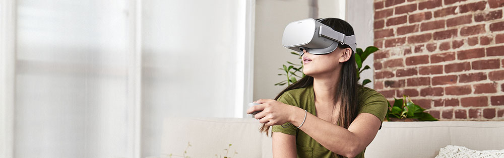 Woman wearing an Oculus Go headset
