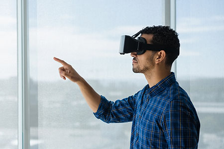 Man using VR in an office and pointing